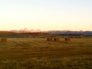 The sun setting over the 50-mile race course, with the Tetons in the distance